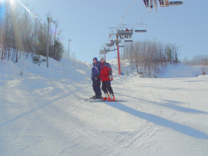Cascad skier with volunteer